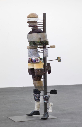 Mariechen Danz, The Dig of No Body, grass, soil, sand, glass, cement, pebbles, horn, wood, coal, styrofoam, plastic trash, shards of glass, shredded paper, epoxy resin, metal, 2011, 186 x 62 x 76 cm