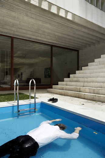 Elmgreen & Dragset, Death of a Collector, Swimming pool, silicone figure, Rolex watch, pack of Marlboro cigarettes, clothing, shoes, 2009, 100 x 600 x 200 cm