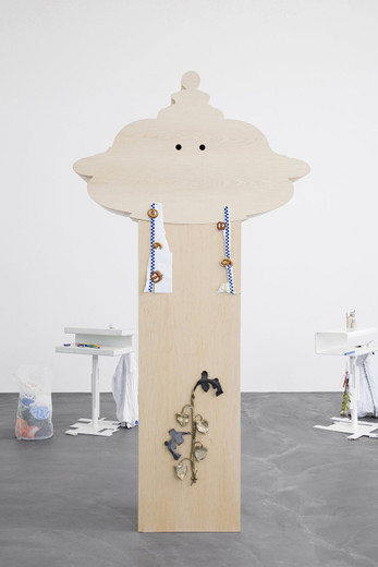 Helen Marten, One for a bin, two for a bench: Friend, Amigo, Sport, Rough sawn Pine; Maple; Ash; cigarette packets; cast bronze; clout nails; hand embroidered pillow; twig, 2012, 250 x 130 x 55 cm