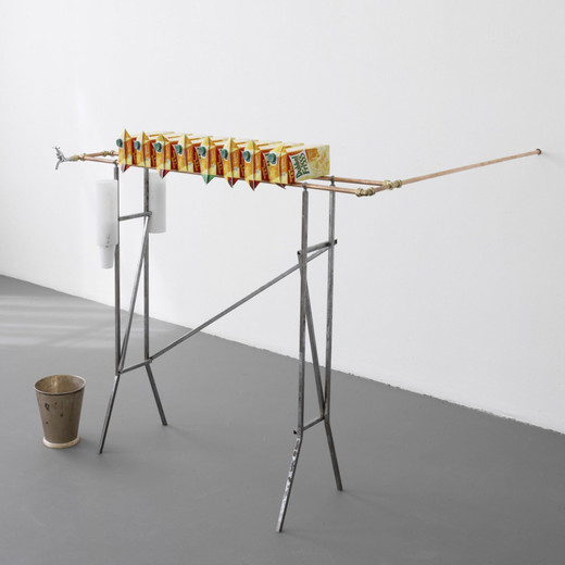 Tue Greenfort, Water cooler, copper tubes, metal frame, plastic cups, water, fruit juice cartons, ice bucket, 2006, 150 x 30 x 100 cm