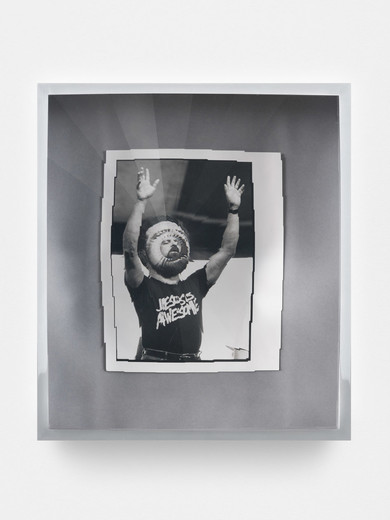 Jeremy Shaw, Towards Universal Pattern Recognition (Claude Missmer of Whitehall raises his arms during a song. 8/21/89), kaleidoscopic acrylic, chrome, archival black/white photograph, 2016, 42.5 x 37.5 x 16 cm, unique