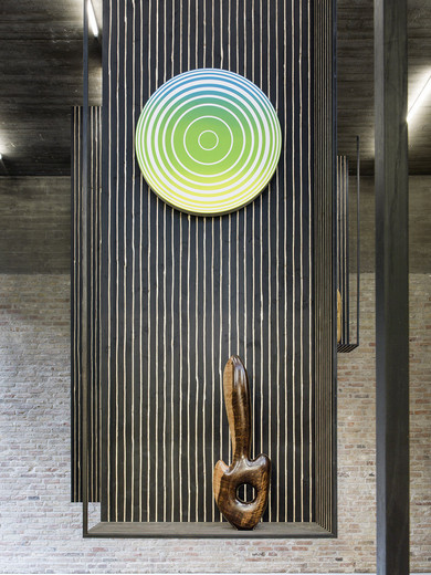 Claudia Comte, Sculpture Object 38: The Beauty / Middle Circle, gradient yellow green blue, ebony, spruce plinth, chainsaw carved, black ink and oil, 2016, 453 x 135 x 45 cm