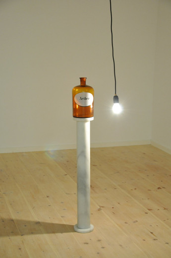 Alicja Kwade, Aether, bottles, marble pedestal, motor, light bulb, cable, 2010, dimensions variable, unique