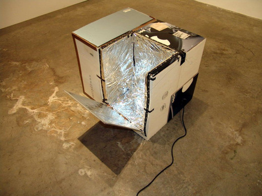 Johannes Wohnseifer, Solar Box (Apple G 4), cardboard, mylar, synthetic pylon, neon tube, 2004, 55 x 70 x 70 cm