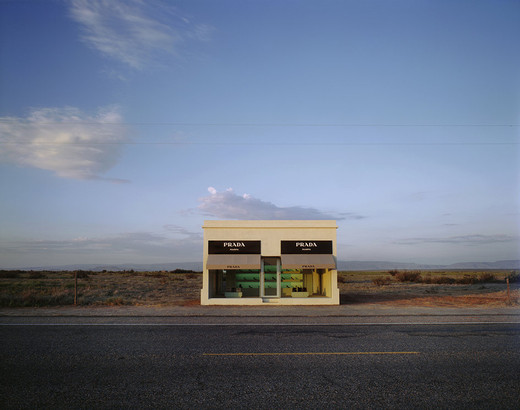 Elmgreen & Dragset, Prada Marfa, Adobe bricks, plaster, aluminum frames, glass panes, MDF, paint, carpet, Prada shoes and bags, 2005, 760 x 470 x 480 cm