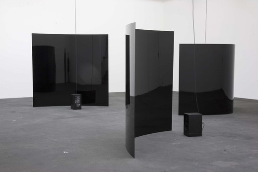 Alicja Kwade, Der Tag ohne Gestern (Dimension 1-3), steel, extra shiny black varnish, speakers, mixer, microphone, neon tube, three parts, 2009, dimensions variable, unique