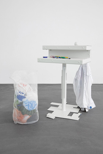 Helen Marten, A face the same colour as your desk (5), Welded/radial bent powder coated steel; stitched fabric; grinded rebar; plastic string; wood; cardboard; pens; stitched mesh; plastic bags; stress ball brain, 2012, 90 x 60 x 70 cm, unique
