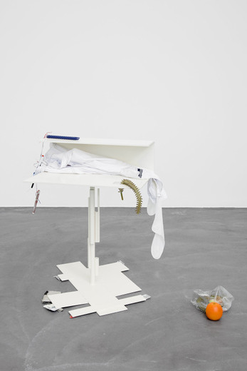 Helen Marten, A face the same colour as your desk (1), Welded/radial bent powder coated steel; stitched fabric; plastic bags; chocolate; cigarettes; cactuses; fruit; grinded rebar; plastic string; wood; pens; cardboard, 2012, 90 x 60 x 70 cm, unique