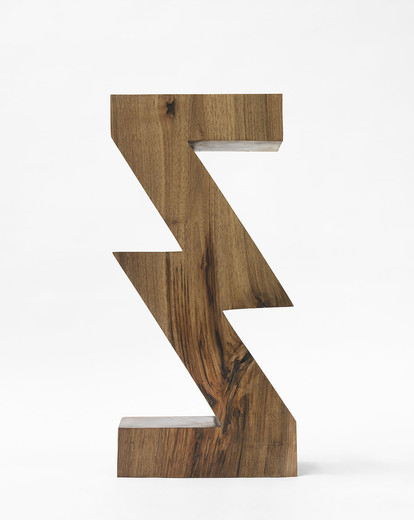 "<span class=""artists work-caption"">Claudia Comte</span><span class=""title work-caption"">Sculpture Object 43: ZigZag Division</span><span class=""technique work-caption"">walnut, spruce plinth, chainsaw carved, black ink and oil</span><span class=""year work-caption"">2016</span><span class=""dimensions work-caption"">Sculpture: 74 x 20 x 34 cm  Plinth: 498 x 135 x 45 cm</span>"