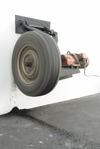 Michael Sailstorfer, Zeit ist keine Autobahn - Berlin, tyre, iron, electronic engine, electric current, wall, 2006, 110 x 100 x 70 cm dimensions variable