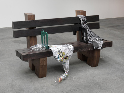 Helen Marten, A lad of fire (menswear bench, or a bold strip suits call for plain shirts and un-patterned ties), solid Black Walnut and Wenge bench, printed newspaper shirts, laser-cut and powder-coated steel, blown glass water bottles, air freshener, rubber bands, 2011, 90 x 160 x 65 cm