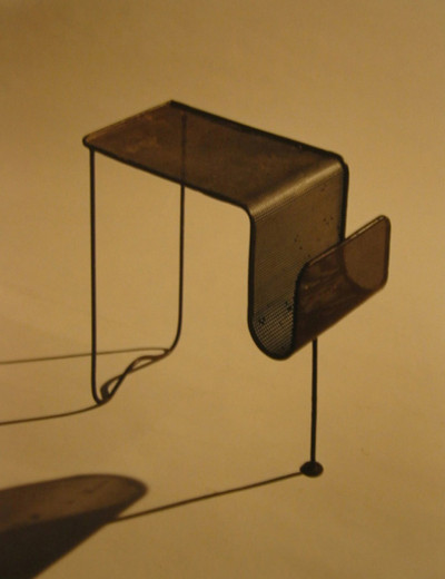 Mathieu Matégot, Magazine rack, perforated metal, 1955, dimensions variable