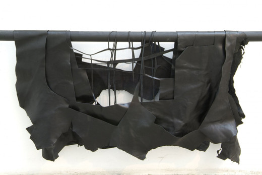 Tatiana Trouvé, Untitled (ref: black leather), leather, wood, 2005 - 2008, 70 x 120 x 8 cm, unique