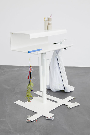 Helen Marten, A face the same colour as your desk (2), Welded/radial bent powder coated steel; stitched fabric; succulent plant; grinded rebar; plastic string; wood; cardboard; clamp; pens; cans; bottle caps; rubber; toilet roll pen holder; nail file, 2012, 90 x 60 x 70 cm, unique