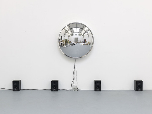 "<span class=""artists work-caption"">Alicja Kwade</span><span class=""title work-caption"">Singularität</span><span class=""technique work-caption"">radio-controlled clock, Plexiglas, four speakers, four microphones, two amplifier</span><span class=""year work-caption"">2009 - 2014</span><span class=""dimensions work-caption"">h = 50,  Ø 110 cm</span><span class=""edition work-caption"">1/2 + 1AP</span>"