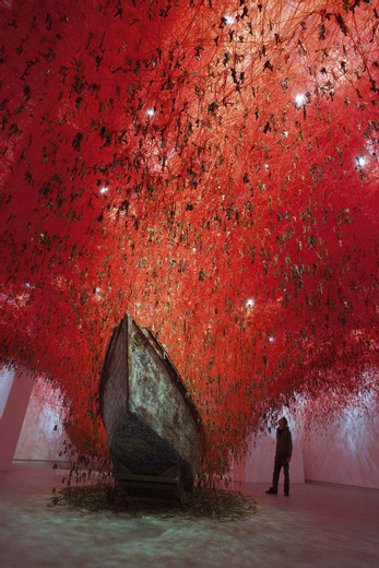 Chiharu Shiota, The Key in the Hand, 2015, Installation: old keys, old wooden boats, red wool Japan Pavilion, 56th International Art Exhibition—La Biennale di Venezia, Venice, Italy Photo by Sunhi Mang © VG Bild-Kunst, Bonn, 2020 and the artist